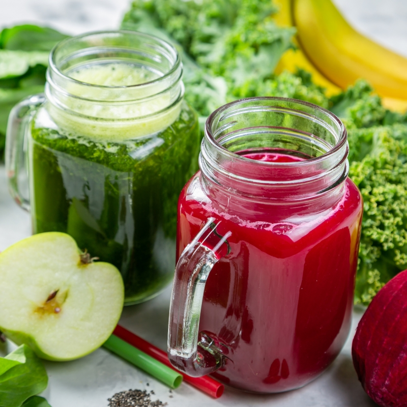 Alkaline diet concept – green and purple smoothies and ingredients